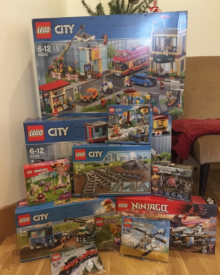 Lego sets piled under Christmas tree