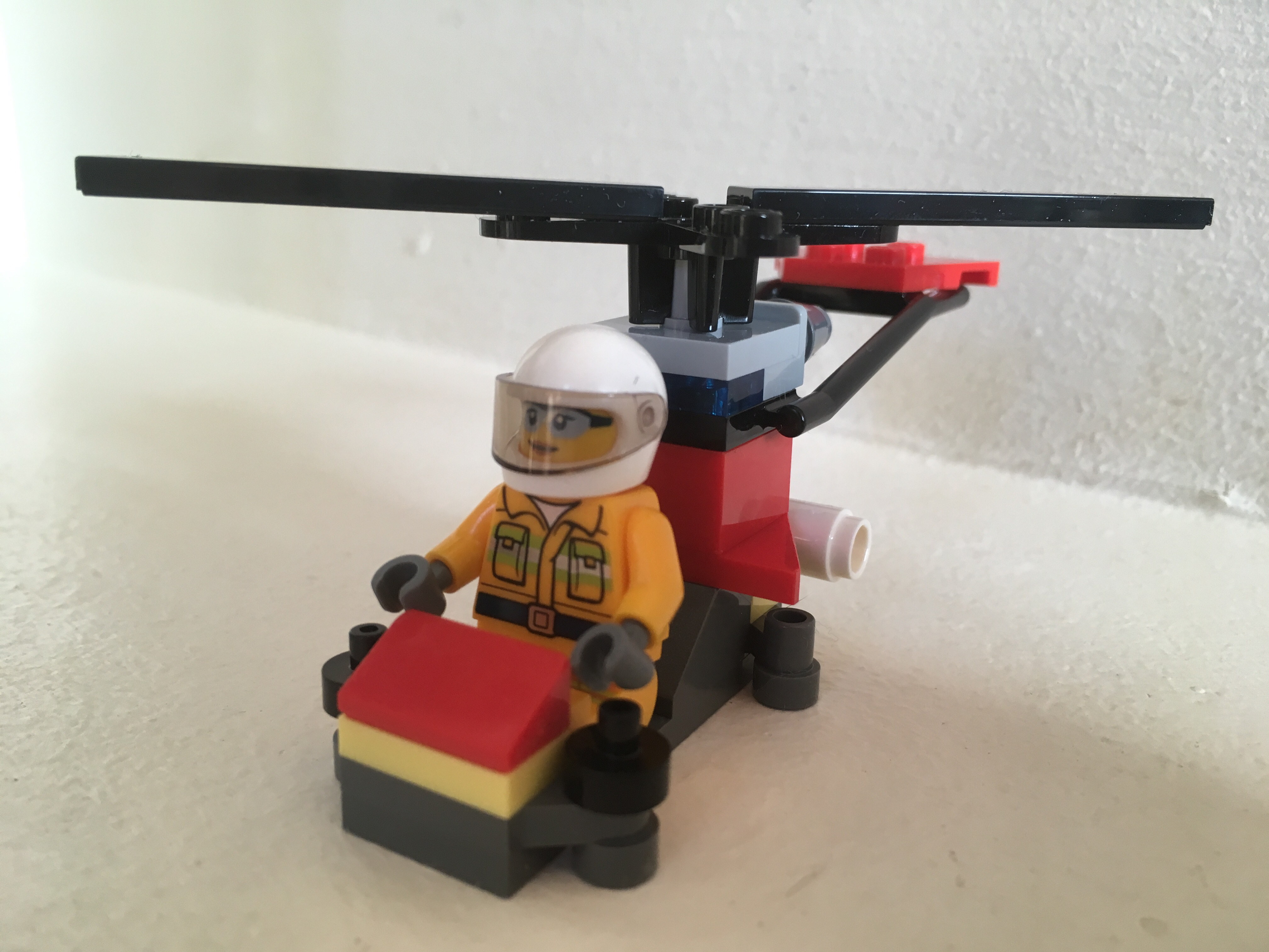 Lego Firefighter Minifigure with helicopter